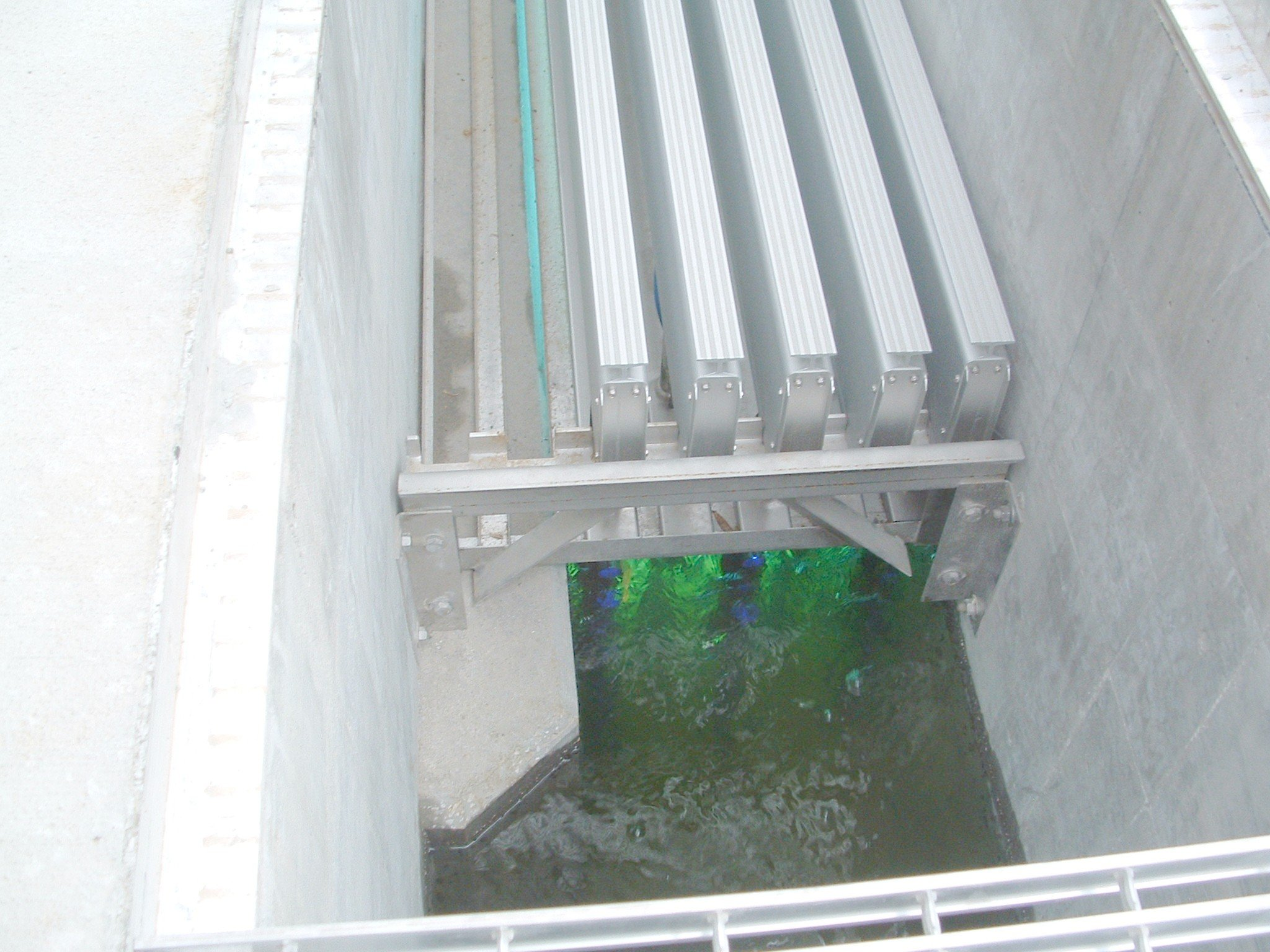 The disinfection chamber seated over some treated wastewater.